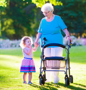 Elderly woman with child holding hands